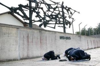 Imams praying at dachau
